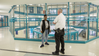 Simone Ujah talking to prison officer